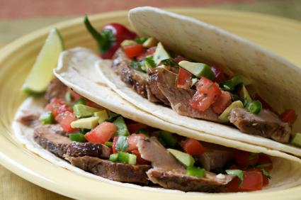 Pork soft tacos, with tomato, jalapeno, avocado, and cilantro salsa