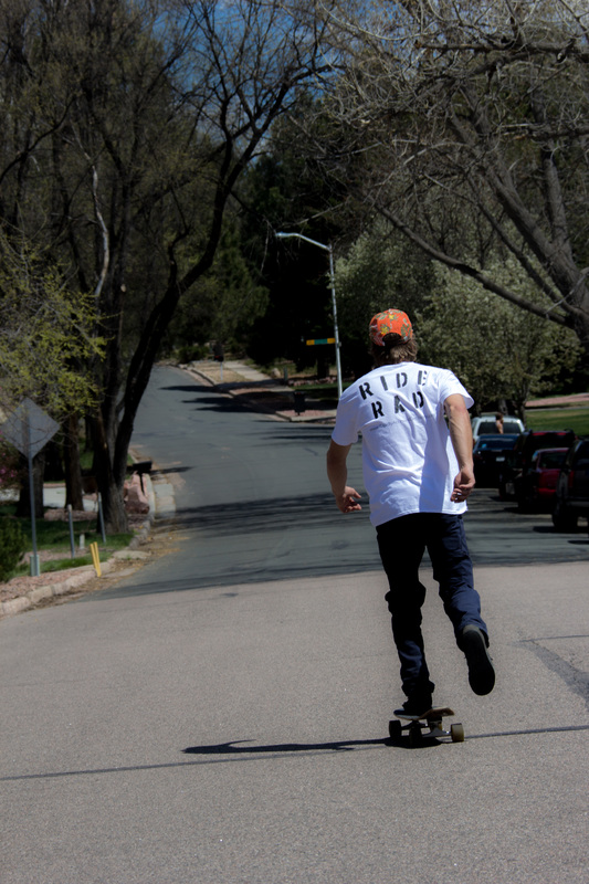 skating outdoors in RAD shirt
